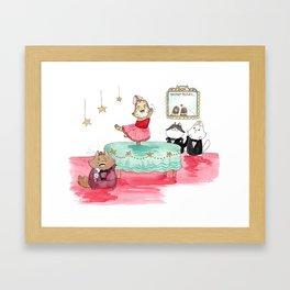 Tabitha catches the red dot. Framed Art Print