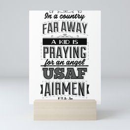 In a country far away, a kid is praying for an angel. USAF Airmen, ETA 3m Mini Art Print
