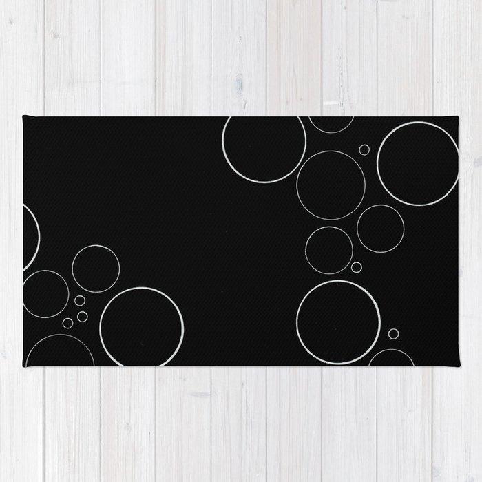 Bubbles on Black Rug