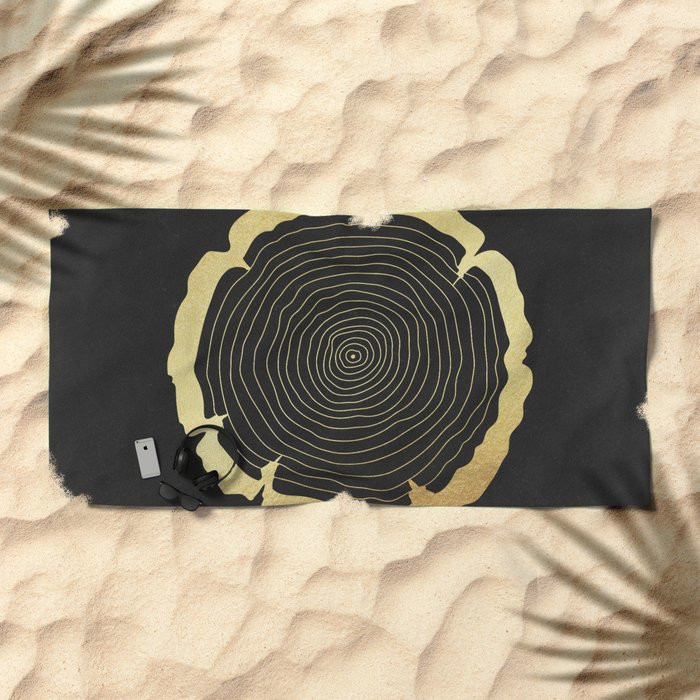 Metallic Gold Tree Ring on Black Beach Towel