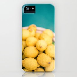 Yellow lemons next to a turquoise pool. | Colorful food photography, tropical feel. iPhone Case