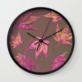 Japanese maple leaves - neon pink on khaki Wall Clock