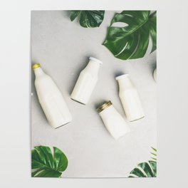 Various bottles of milk and tropical leaves Poster