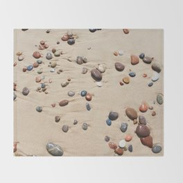 Wet sand and stones on beach Throw Blanket