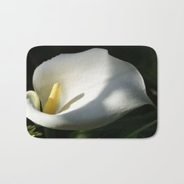 White Calla Lilies Over Black Background In Soft Focus Bath Mat