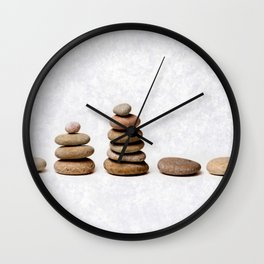 Zen stones in a row Wall Clock