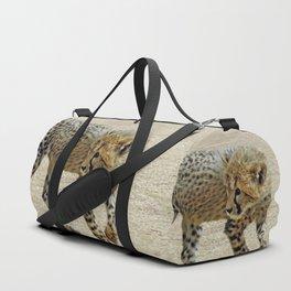 Baby cheetah learning to stalk Duffle Bag