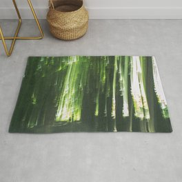 Light in the tree alley Rug