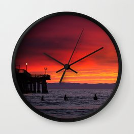 Surfers watching Sunset Wall Clock