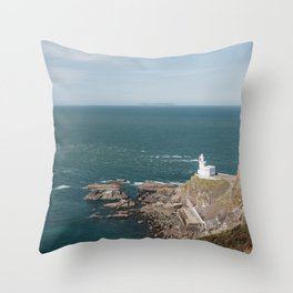 Lighthouse at Hartland Quay with Lundy Island beyond. Devon, UK. Throw Pillow