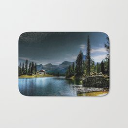 Lake in forest with house and sky covered with black clouds Bath Mat