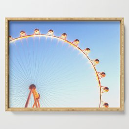 orange Ferris Wheel in the city with blue sky Serving Tray