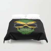 jamaica Duvet Covers featuring Dark Skull with Flag of Jamaica by Jeff Bartels