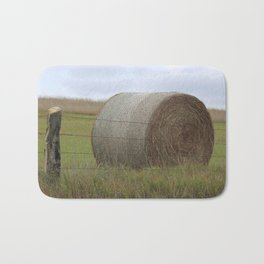 Kansas Hay Bale in a field with a fence Bath Mat