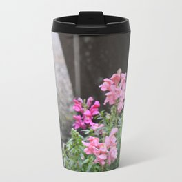 Flowers grow next to old mining equipment Travel Mug