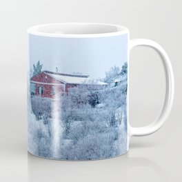 Red house lost in a snowy storm Coffee Mug