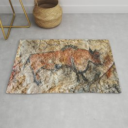 Cave painting in prehistoric style Rug