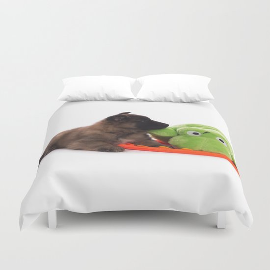 Puppy cuddling green toy Duvet Cover