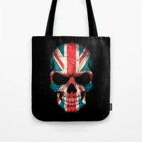 british flag Tote Bags featuring British Flag Skull on Black by Jeff Bartels