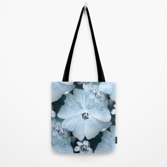 Flower-power - pastel blue flowers on a dark blue background Tote Bag