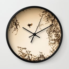 Bird flying in English winter trees Wall Clock