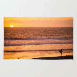 Surfer watching sunset in Southern California Rug