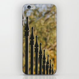 iron fence, yellow leaves iPhone Skin