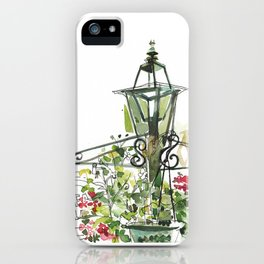 Lamp post with hanging flowers iPhone Case