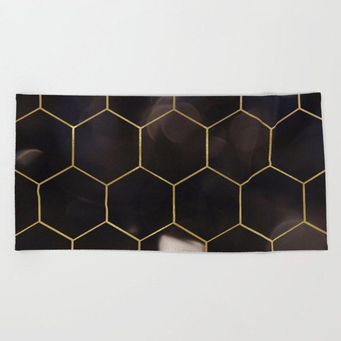 Dark bokeh gold hexagons Beach Towel