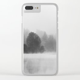 Trees disappearing in morning fog above the lake Clear iPhone Case