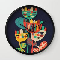 budi satria kwan Wall Clocks featuring Wild Flowers by Picomodi