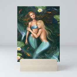 Beautiful fantasy princess mermaids in lake with lilies underwater background Mini Art Print