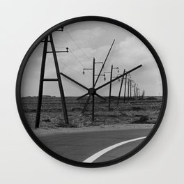 without a destination  Photo by Andrea Scuratti Wall Clock