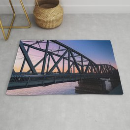 Sunset on rail bridge Rug