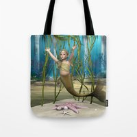 little mermaid Tote Bags featuring Little Mermaid by Design Windmill