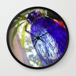 Blue glass and plant Wall Clock