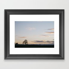Tree on a hilltop above Matlock silhouetted at twilight. Derbyshire, UK. Framed Art Print