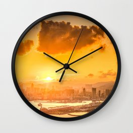 warm color tone orange sunset over hong kong urban city skyline at seafront Wall Clock