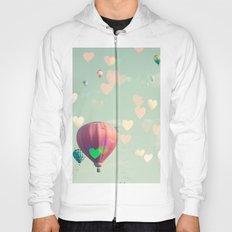 Hot air balloon nursery and heart bokeh on pale blue Hoody