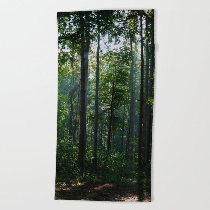 Green forest shrouded the sun. Beach Towel