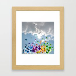 Butterflies in blue sky Framed Art Print
