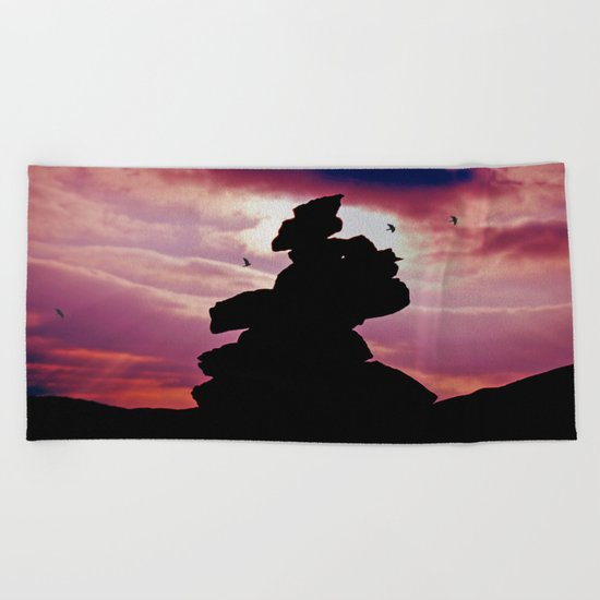 Cairn and clouds Beach Towel