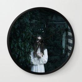 Woman in the dark Wall Clock
