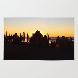 Seaside Sunset behind the wharf remains Rug