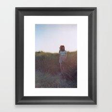 in the grass Framed Art Print