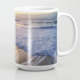 White waves crashing into mossy rocks, with a beautiful autumn sunset. Coffee Mug