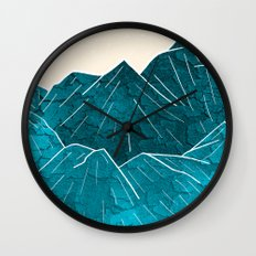 Mountains under the white sun Wall Clock