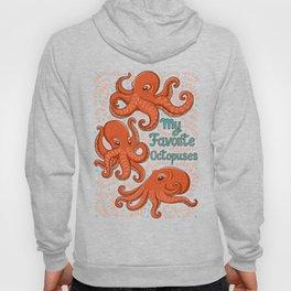 Fun orange octopus on turquoise background. Hoody