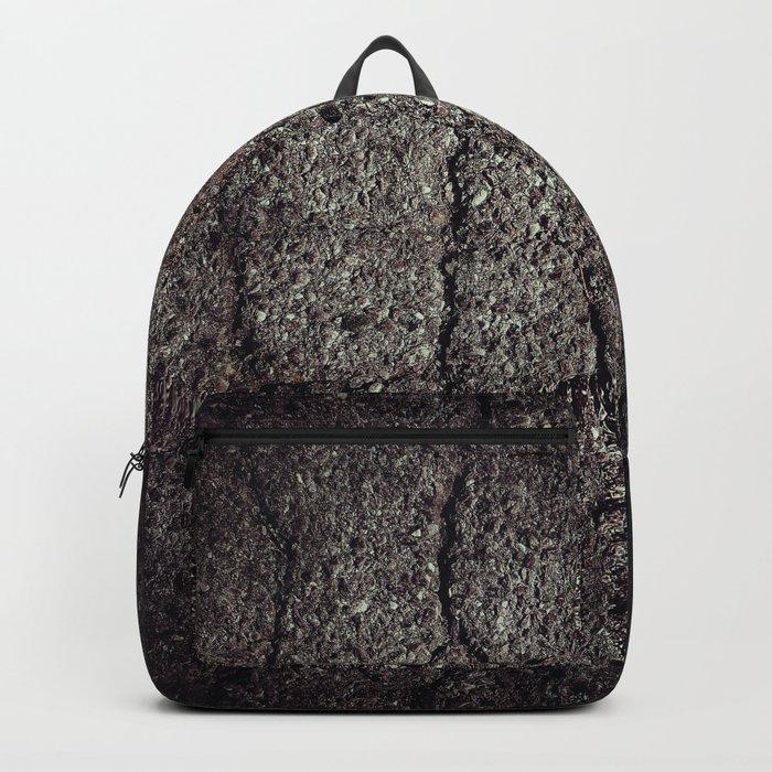 Cracked asphalt road Backpack