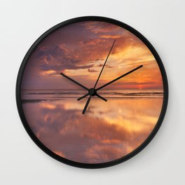 Sunset reflections on the beach, Texel island, The Netherlands Wall Clock